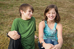 Who farted. Silly expressive pre-teen siblings. Brother looks proud while sister looks happily disgusted Stock Photo