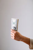 Who got the money. A woman hold a lot of money in her hand Royalty Free Stock Photos