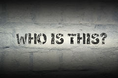 Who is this gr. Who is this question stencil print on the grunge white brick wall stock images