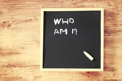 Who am i concept written over chalkboard Stock Photography