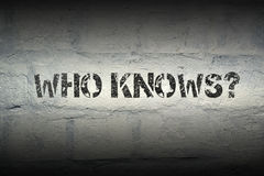 Who knows gr. Who knows question stencil print on the grunge white brick wall stock images