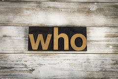 Who Letterpress Word on Wooden Background. The word `who` written in wooden letterpress type on a white washed old wooden boards background stock photography