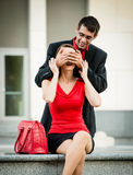 Who is it? - Man surprises woman Stock Photography