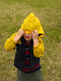Who Me?. Young boy pulling hood over eyes royalty free stock image