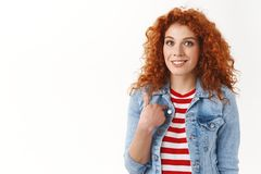 Who me. Gorgeous redhead femenine woman surprised being chosen pointing herself index finger smiling broadly standing. Delighted wondered receive compliment stock photography