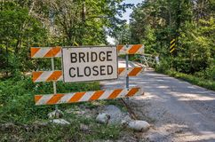 Bridge Closed Sign on Side of Road Royalty Free Stock Photos