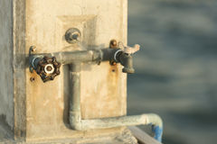 Who needs a drink?. A water faucet in the marina stock photo