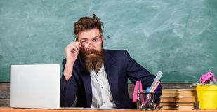 Who ready to answer question. Teacher bearded hipster with eyeglasses sit in classroom chalkboard background. School stock photos