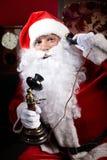 Who s calling Santa? Stock Photo