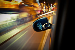 Who's driving my car?. At Halloween, if you look in the wing mirror while you drive you may see things other than your face Royalty Free Stock Images