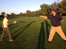 Who's Golfing. Golf sword fight clubs fencing shadows royalty free stock photos