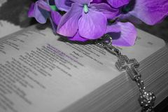 Who Shall I Fear. Cross and flowers photographed with Psalm of David 27:1 Stock Image