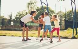 Who is stronger than that will win. Family playing basketball royalty free stock photography