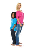 Who is taller?. Rasta boy and young blonde woman posing in studio Stock Photo