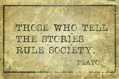 Tell stories print. Those who tell the stories - ancient Greek philosopher Plato quote printed on grunge vintage cardboard Royalty Free Stock Photo