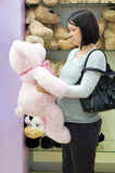 Who is thin?. Pregnant woman shopping for toys for baby royalty free stock images