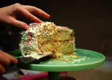 Who wants another slice of cake? Stock Image