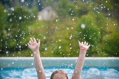 Who wants to swim? Raise the hands! stock images