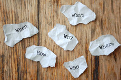 Who, what, when, why, where, how,. Crumpled pieces of paper with the questions who, what, when, why, where, how royalty free stock image