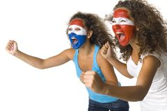 Who will win?. Young, screaming Austrian and  Dutch or Paraguayan sport's fans with painted flags on faces and with clenched fists. Side view, white background Royalty Free Stock Image