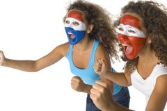 Who will win?. Young, screaming Austrian and  Dutch or Paraguayan sport's fans with painted flags on faces and with clenched fists. Side view, white background Royalty Free Stock Photography