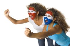 Who will win?. Young, screaming Austrian and  Dutch or Paraguayan sport's fans with painted flags on faces and with clenched fists. Side view, white background Royalty Free Stock Images