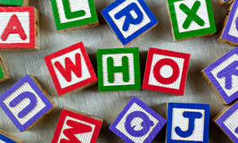 Who. Wooden blocks forming the word WHO in the center royalty free stock images