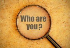 Who are you?. Magnifying glass focused on the question who are you Royalty Free Stock Photography