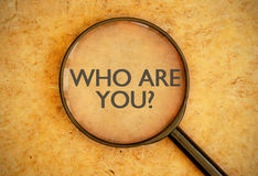 Who are you?. Magnifying glass focused on the question who are you Stock Photo