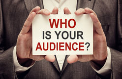 Who is your audience. Card with text in businessman hands stock photo