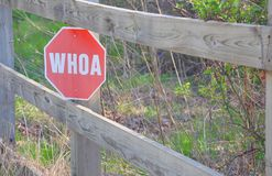 Whoa sign. Sign on fence on country road Royalty Free Stock Photography
