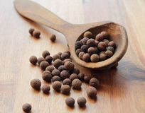 Whole allspice. Aroma latin allspice peppers on a wooden spoon stock photos