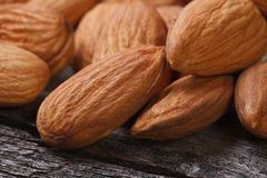 Whole almonds close up on an old wooden table Stock Photo