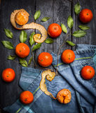 Whole And Peeled Tangerines With Leaves On Blue Rustic Wooden Background Stock Photos