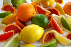 Free Whole And Sliced Fresh Citrus Fruits Of Oranges,lemons And Limes Stock Photography - 210829892