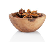 Whole anise stars in bowl Stock Images