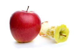 Whole apple and core Stock Images