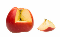 Whole apple and cut-out quarter section. Ripe apple and its section isolated on white Royalty Free Stock Image