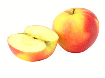 The whole apple and half of appl Stock Images