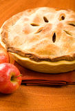 Whole Apple Pie. In yellow baking dish on wood surface Stock Photo