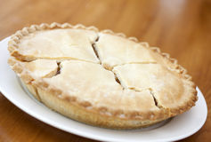 Whole apple pie. On wooden table Stock Photos