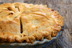 Whole apple pie. Delicious whole fresh baked rustic Apple Pie with table setting royalty free stock photo