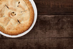 Whole Apple Pie Over Wooden Table Top Stock Photography