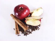 Whole Apple, Sections, and Spices Royalty Free Stock Photography