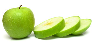 Whole apple and slices Royalty Free Stock Image