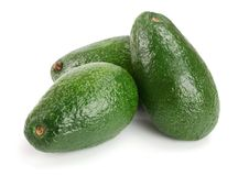 Whole avocado isolated on white background close-up Stock Images