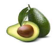 Whole avocado leaves half cut isolated on white background Royalty Free Stock Photography
