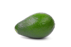 A whole avocado  on a white background. A nutritious avocado full of vitamins. An avocado for a delicious guacamole sauce. A single whole saturated light green Stock Photos