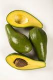 Whole avocados and a avocado cut in a half. Stock Photography