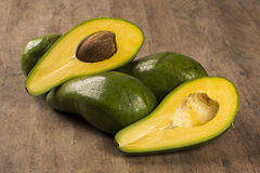 Whole avocados and a avocado cut in a half. Royalty Free Stock Photo